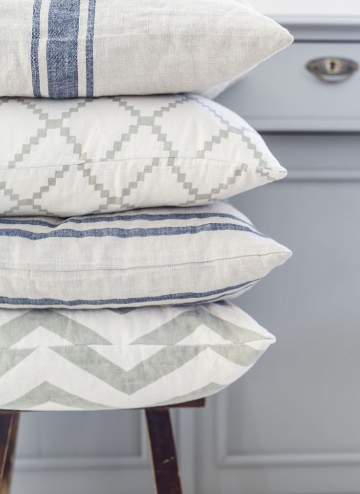 Pillows with denim blue and charcoal gray patterns.