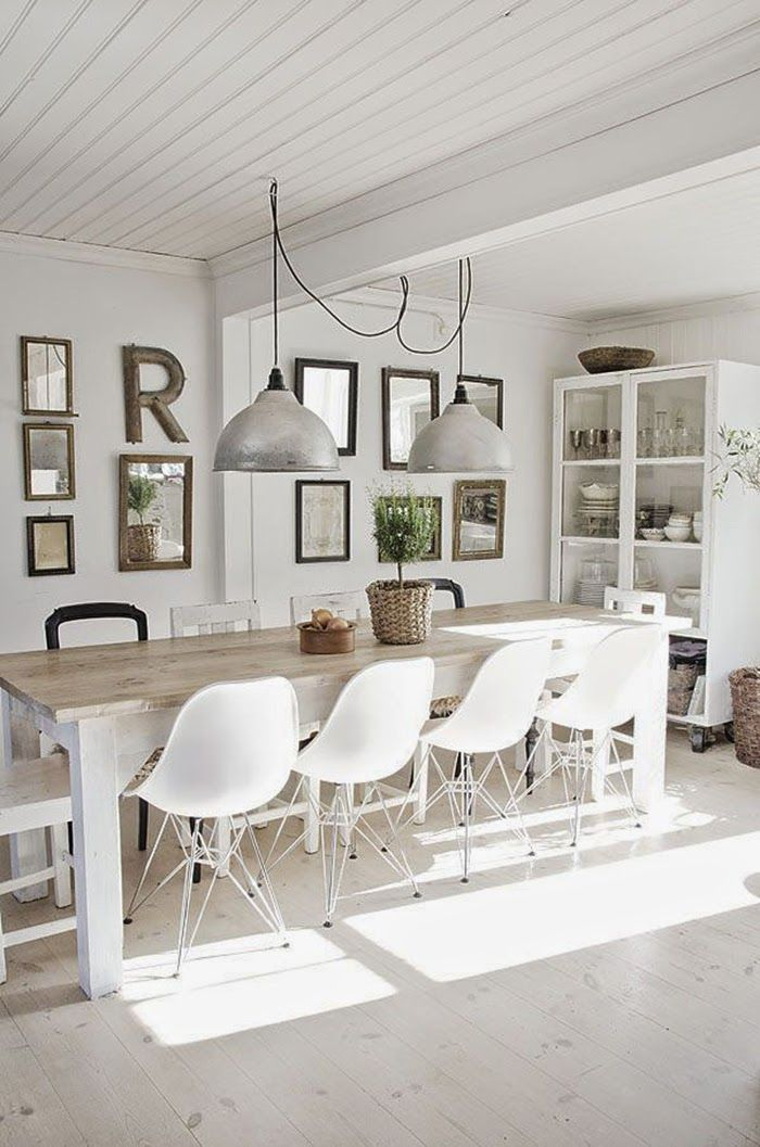 {dining gallery} bright and white eating area backed by a gallery wall. #farmhouse