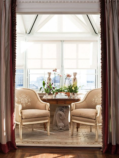 A Light Filled Conservatory Offers A Cozy Seating Area For Two. Design:  Antonio Martins. Traditional ...