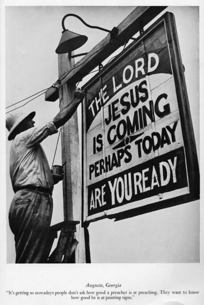 """""""It's getting so nowadays people don't ask how good a preacher is at preaching. They want to know how good he is at painting signs"""" --- photo by Margaret Bourke-White. (Augusta, Georgia)."""
