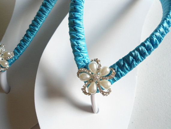 Beautiful white wedge flip flops embellished with turquoise ribbon and one of a kind pearl flower button!