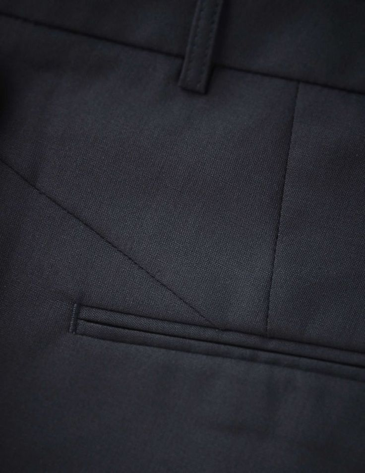 Yulia trousers - Women's trousers in wool-stretch. Features two back paspoil pockets, two front pockets and cutlines at back. Regular waist with straight leg. For a complete suit look wear it with Emika blazer
