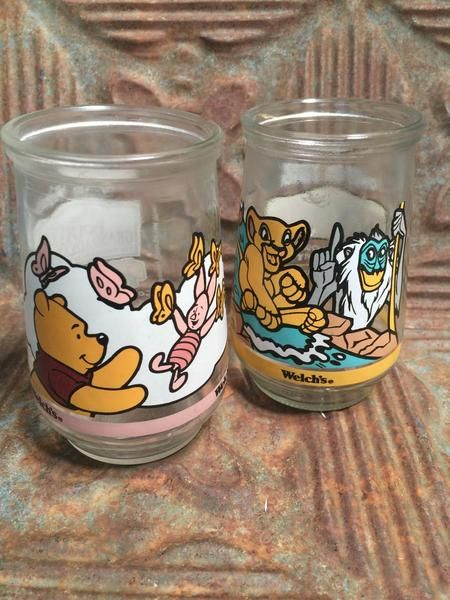 Adorable vintage juice glasses that we're a part of a promotional campaign for Welch's juice. These are two of the Disney series and the set includes 1 Winnie the Pooh and 1 Lion King. In very good vintage condition with bright colors.