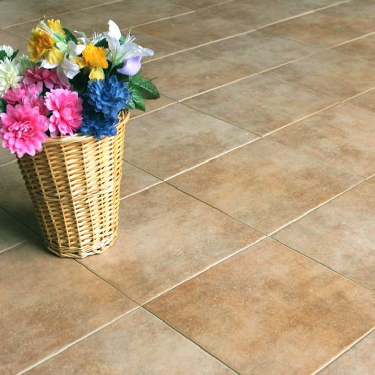 A medium sized terracotta coloured stone effect floor tile, specifically designed to stop the tile getting slick when wet, even when submersed in water. the tile has a coarse surface with a sandy grain, it is stone effect tile which is interesting and practical. Suitable for outdoor and indoor use.