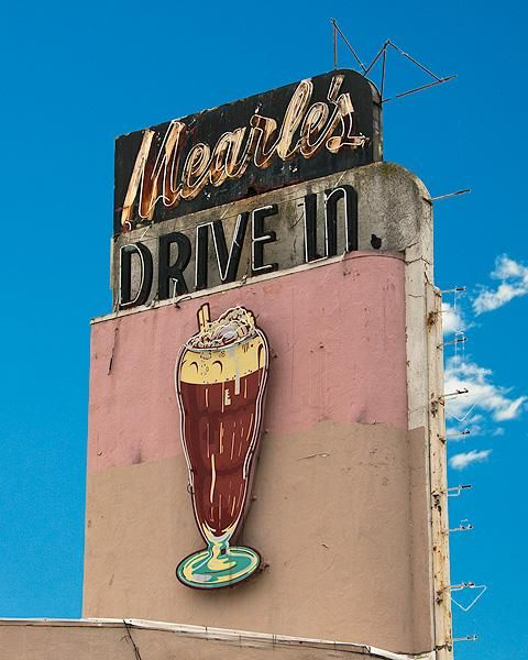 Mearle's Drive-In in Visalia, California. This much loved Visalia landmark opened in the early 1940s as 'Tad's Drive-in'. It was known for fantastic food and happy roller skating car hops. But most of all that memorable neon sign flashing in the night sky was the drawing card to eat. In 1961 the business was sold to Mearle Heitzman, hence forth the name 'Mearle's Drive-In'.