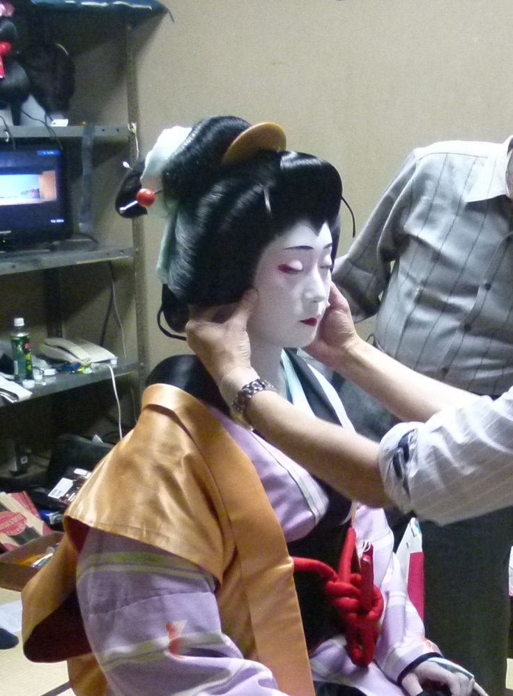 kabuki costume and makeup. skin- makeup in traditional theatre setting the wig for kabuki costume. costume and