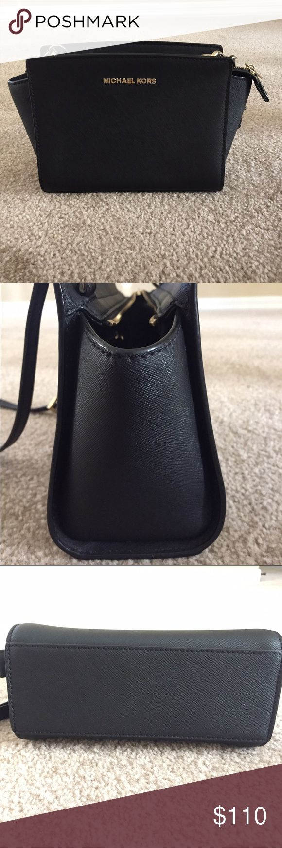Michael Kors Selma Medium Black Crossbody Handbag Popular Selma in an excellent condition. Small scratches on the hardware. No sign of wear on the leather Michael Kors Bags Crossbody Bags