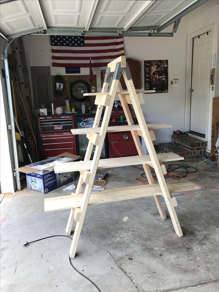 Ladder shelf using sawhorse brackets. Sawhorse brackets