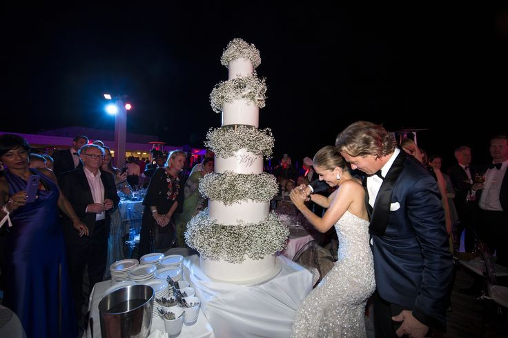 TRIESTE, ITALY - JUNE 16:  (GERMANY, AUSTRIA, SWITZERLAND OUT UNTIL 26 June 2017) Victoria Swarovski and Werner Muerz cut the cake during their wedding on June 16, 2017 in Trieste, Italy. (Photo by Chris Singer/Johannes Kernmayer/CUEX GmbH/Getty Images) via @AOL_Lifestyle Read more: https://www.aol.com/article/lifestyle/2017/06/21/heiress-victoria-swarovski-crystal-wedding-gown/22528718/?a_dgi=aolshare_pinterest#fullscreen