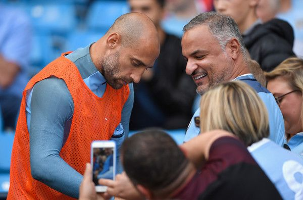 Pablo Zabaleta Photos Photos - Pablo Zabaleta of Manchester City signs Manchester City fans autographs during the Premier League match between Manchester City and AFC Bournemouth at the Etihad Stadium on September 17, 2016 in Manchester, England. - Manchester City v AFC Bournemouth - Premier League