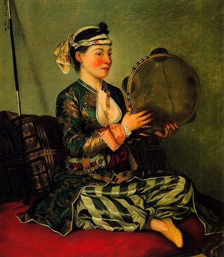 """A concubine playing the tambourine."" Concubines would play some instruments according to their skills"