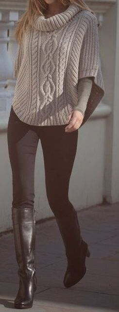 Truly feminine look: oversized gray turtleneck jersey intelligently disguise the curves, while skinny black pants and black leather knee-high boots creates a sexy silhouette