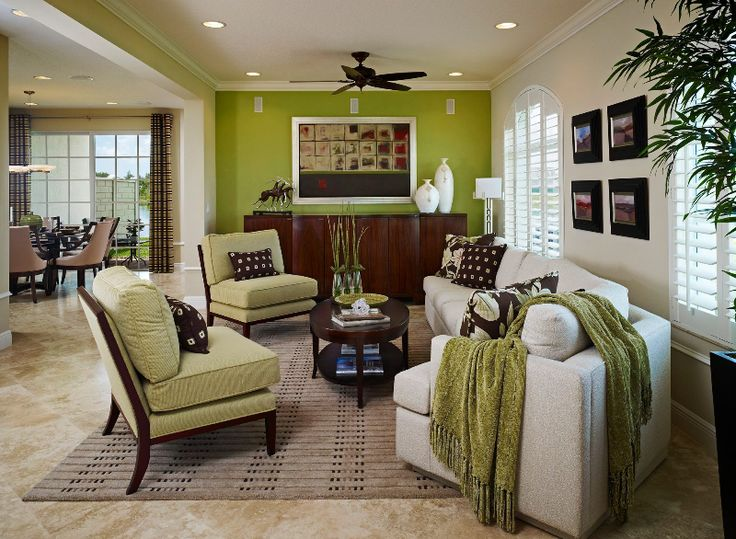 A Green Accent Wall Becomes The Focal Point In This Trendy Living Room Jupiter Country Club Florida