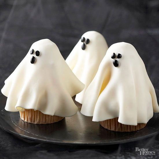 Supernatural forces can't chain these ethereal cupcake ghosts to your Halloweentable. They'll vanish as soon as your guests glimpse their billowing forms and taste the white chocolate cupcakes hidden beneath the fondant phantoms. Use our cupcake decorating ideas below to complete each of these ghostly treats: 1. Generously pipe frosting onto a 2-1/2-inch cupcake. Remove paper bake cup from a 1-3/4-inch cupcake and place the small cupcake, upside down, on top of the large cupcake…