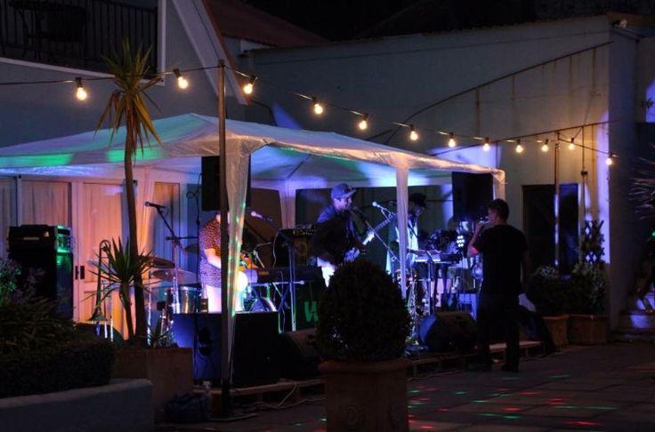 The band setup at Sarah & Rusty's wedding at the stunning Pihama Lavender Farm. #festoons #TSHWeddings