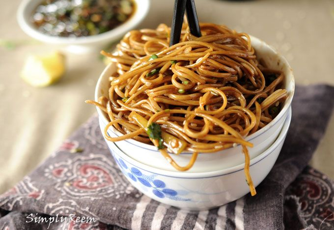 Soba Noodles with Ginger Scallion Sauce.  I'd probably saute some chicken for the kids to add in, and that way it can be vegetarian as well.