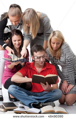 The clever young people  sitting with books on a white background.