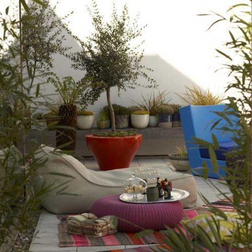 37 Wonderful Bohemian Patio Designs : 37 Beautiful Bohemian Patio Designs With White Stone Wall Sofa Purple Cushion Carpet Plant Pots Stone Floor