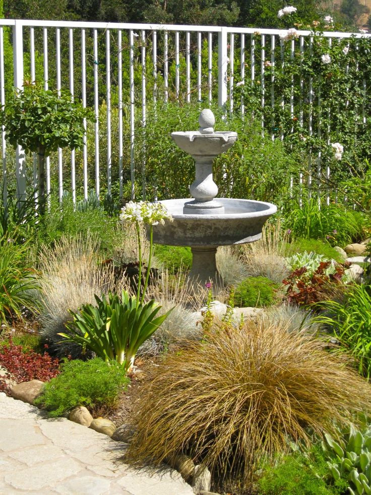 ornamental grass gardens ideas ornamental grasses surround a - Garden Design Using Grasses