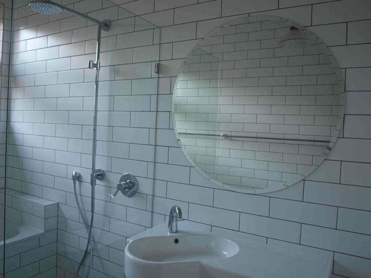My Bathroom. centre stage is a bevilled edge circular mirror borrowing from the art deco heritage of the building.