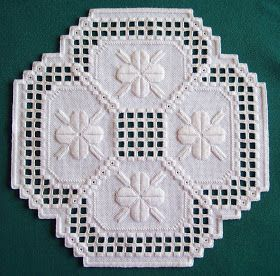 I finished my round Hardanger doily a few days ago.  So, I thought I'd post a picture of it here.          Here is the doily in all of it's ...