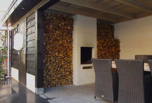 Leuk, eettafel in de veranda en het hout tegen de muur, kan bij ons ook!