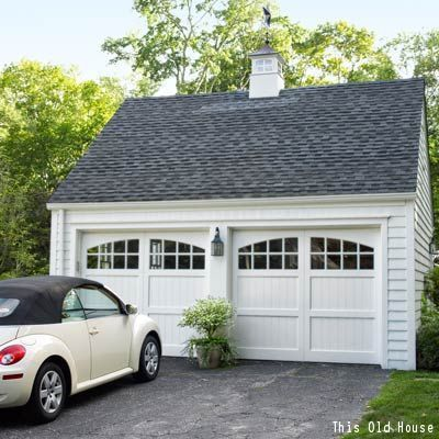 custom doors a cuppola and light fixture transform this garage from eye sore to attraction