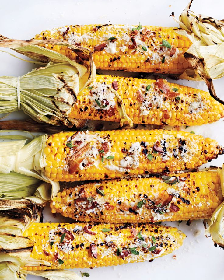 Our new favorite way to enjoy sweet high-summer corn is to grill it, then pair it with bits of smoky, crisp bacon for a Mediterranean twist on the classic Mexican snack.