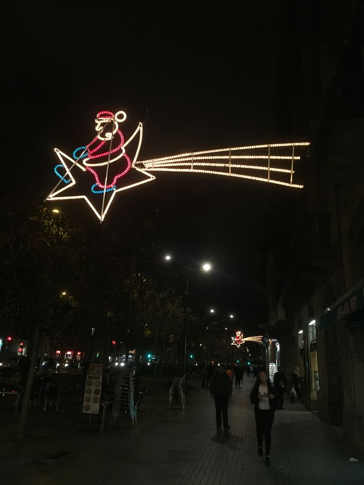 This christmas decoration is located in front of the Arc De Triomf on the street Passeig de Sant Joan. It depicts Santa Claus riding a shooting star and contains the traditional red suit of Santa, his blue gloves, and the shooting star is the classic gold color.