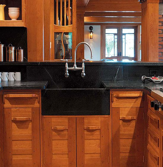 Slate, soapstone, and honed granite are timeless materials for countertop and backsplash, for houses of almost any period.