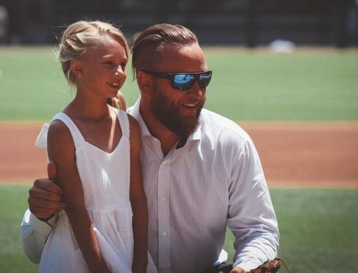 Mark Buehrle and daughter Brooklyn pose moments before her first pitch prior to Saturday's A's-White Sox game. June 24, 2017