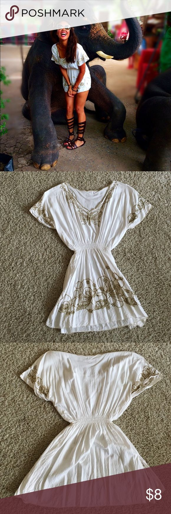 Top White smock top with gold embroidered details.  Condition:  good.  Size:  S. Tops Tunics