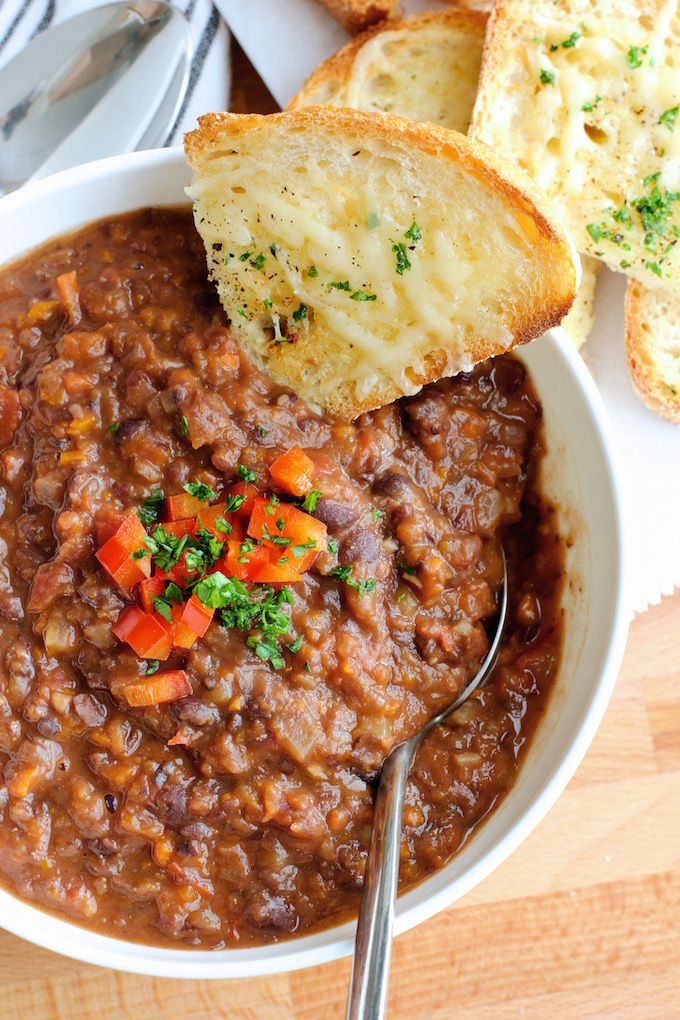 Black bean and vegetable soup - from Green Valley Kitchen - a hearty, vegetable packed black bean soup with a spicy kick. The perfect soup for frosty days.