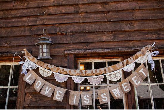 33 Creative Wedding Signs to Bring Personality to Your Big Day: A simple way to create a bit of unity throughout the festivities? Design a gorgeous monogram logo to include on all your paper goods and signage.   Source  : With a dainty lace garland and letters stamped on burlap, this hanging banner is rustic charm at its finest.  Source