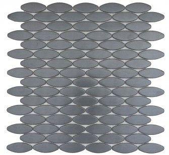 black oval stainless steel tile beyond tile