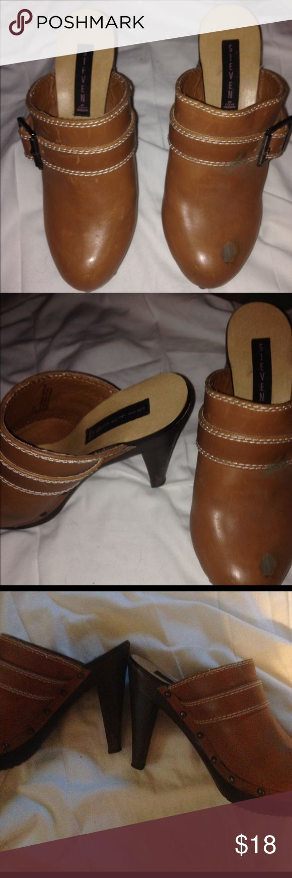 """Steve Madden 4"""" high heeled Clogs. Lovely SZ 8 Brownish gold high heeled Clogs by Steve Madden.  As soon in photo, the left top shoe has some damage. Maybe be able to bring to a shoe shop to get fixed. Otherwishes in flawless condition. Worn twice. Heels are 4inches and have no wear. Since is 8. True to size. A great addition to your collection. Steve Madden Shoes Mules & Clogs"""