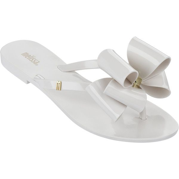 Melissa Harmonic Twin Bow White ($48) ❤ liked on Polyvore featuring shoes, sandals, flip flops, white, metallic shoes, gold flip flops, white flip flops, white sandals and gold shoes