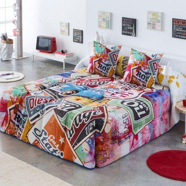 Edredón Conforter ARIZONA de la firma Sansa. Presenta un estampado formado por antiguas etiquetas comerciales acompañas de pinceladas de colores.