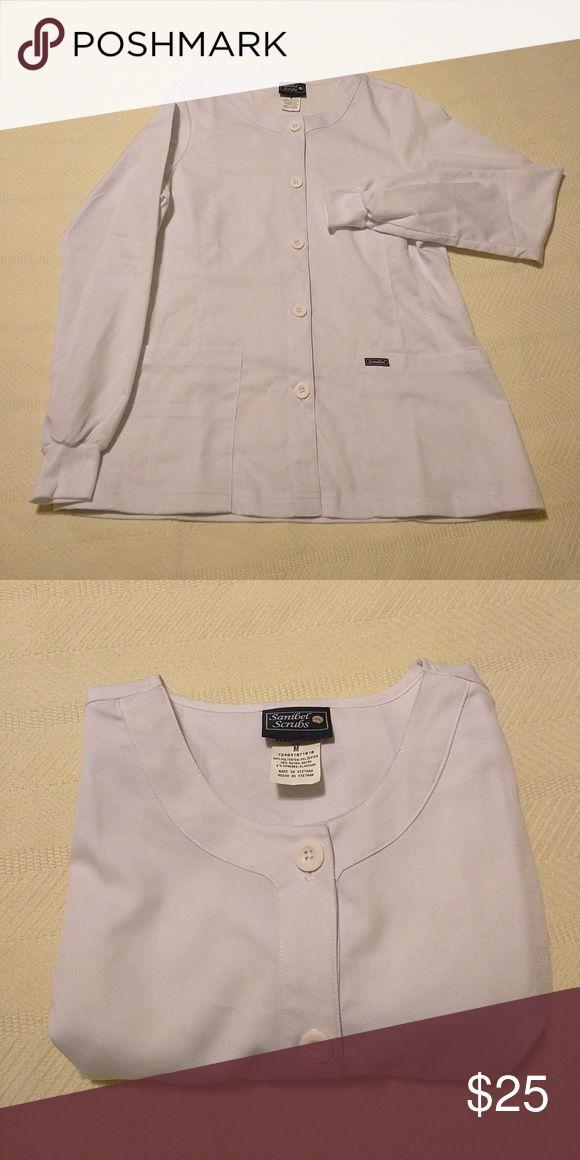 Sanibel Scrubs Long Sleeve Jacket Sanibel Scrubs, Long sleeve jacket with two front big pockets!! Size M. NWOT!!! Sanibel Scrubs Jackets & Coats Utility Jackets