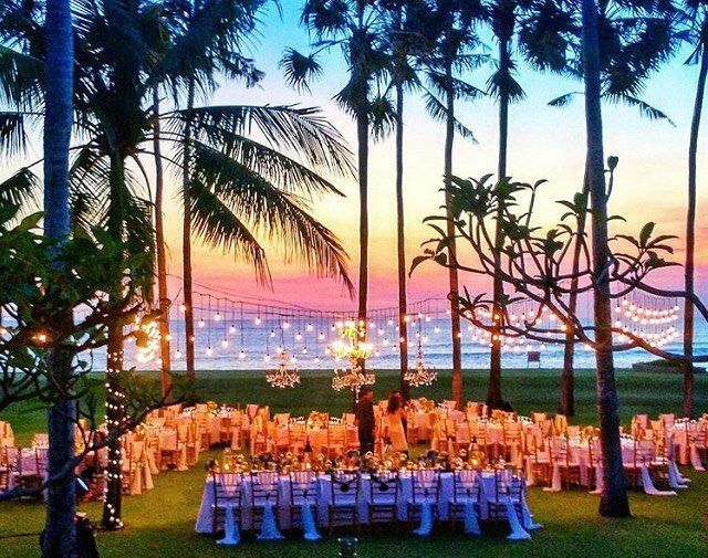 Bali Wedding Inspo   Bali wedding venues   Sunset, hanging lights and long tables... Gush! Bali event hire