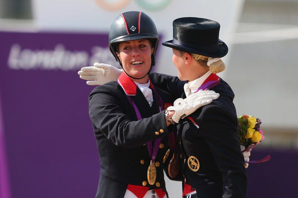 Charlotte Dujardin Photos Photos - Gold medallist Charlotte Dujardin (L) of Great Britain riding Valegro and Laura Bechtolsheimer of Great Britain riding Mistral Hojris celebrate with their medals during the medal ceremony following the Individual Dressage on Day 13 of the London 2012 Olympic Games at Greenwich Park on August 9, 2012 in London, England. - Olympics Day 13 - Equestrian