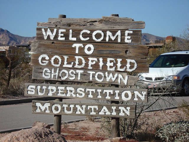 Goldfield Ghost Town E Apache Trail, Apache Junction, Arizona 85219 USA 480-983-0333. Located between both the Superstition Mountains and Goldfield Mountains is a famous little ghost town, aptly named the Goldfield Ghost Town. Established in 1893, this town is literally surrounded by mystery, legends of gold, and vengeful spirits.