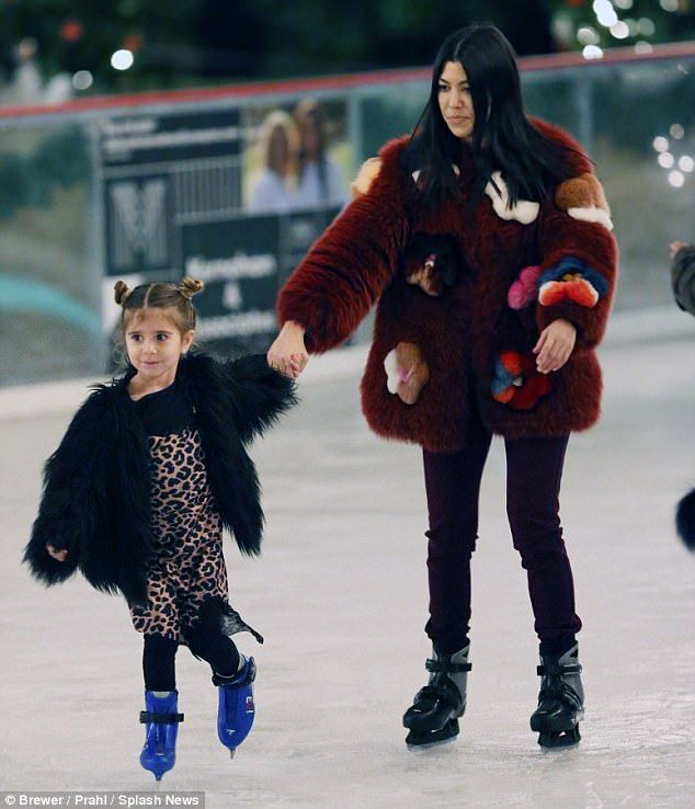 Showing her how it's done: After a time the loved-up couple was joined by her five-year-old daughter Penelope, who seemed to actually be a more proficient skater than her reality star mother