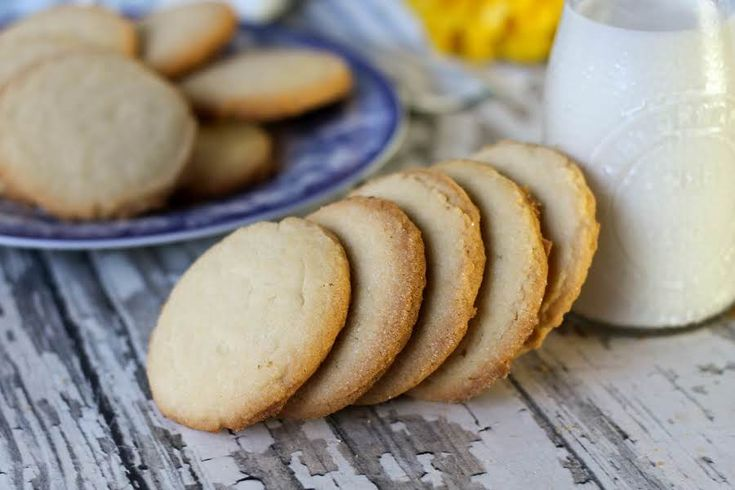 Every time we went to grandma's she would have a tin of these cookies in the cupboard. I usually make them at Christmas and use colored sugars in place of white sugar when I flatten them. I dare you to eat just one!