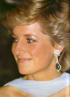 Princess Diana Jewelry DIAMOND AND AQUAMARINE DANGLE EARRINGS This pear-shaped aquamarine is surrounded by diamonds and hangs from a diamond flower cluster.