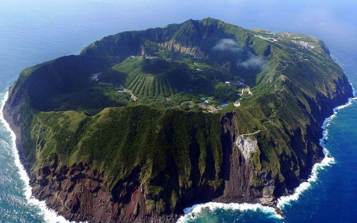 Aogashima, Japan Aogashima is a volcanic island located 200 miles off the coast of Tokyo. Even more amazing than the view is the geography – there's a smaller volcano within the volcano island.