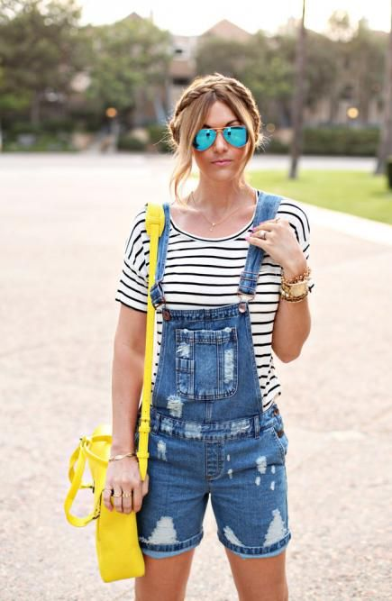 We love how Caitlin of A Little Dash of Darling played up this classic look with color, an arm party, and braids. #Style #Overalls