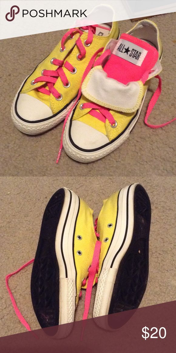 Converse Double Tongue Low More like neon yellow and neon pink. Double tongue as seen in the picture. It can be completely yellow and if you flip the tongue down it can be pink. Women's size 5. Men's size 3. Lightly Worn. Converse Shoes Sneakers