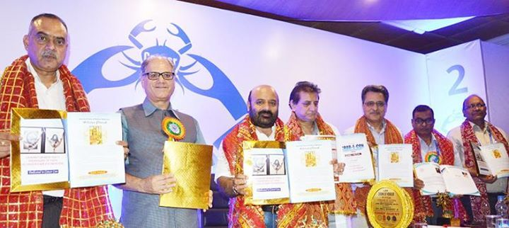 Minister for Health and Medical Education and others releasing souvenir of National Level Cancer Conference at Jammu.