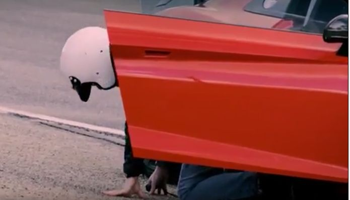 Chris Evans, host of the 2016 series Top Gear, in the position for which he will be best remembered. But the best view of him is from the behind - after BBC kicked his ass out the door on 4 July 2016.